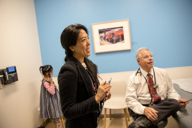 DBP Fellow Dr. Dan Won and Dr. David Ansel pictured, consult with parents, not pictured, as a child plays in the corner.