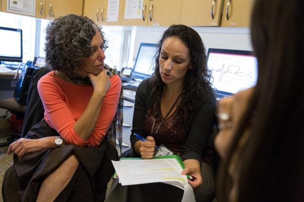 Dr. Heidi Feldman discusses a case with Dr. Lauren Hubner.