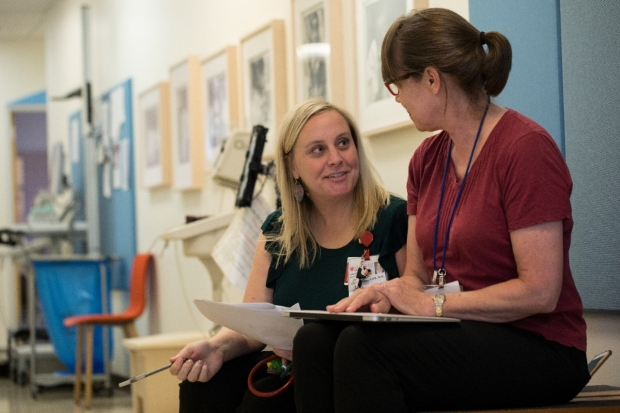 A developmental-behavioral pediatrics fellow meets with one of our faculty members.